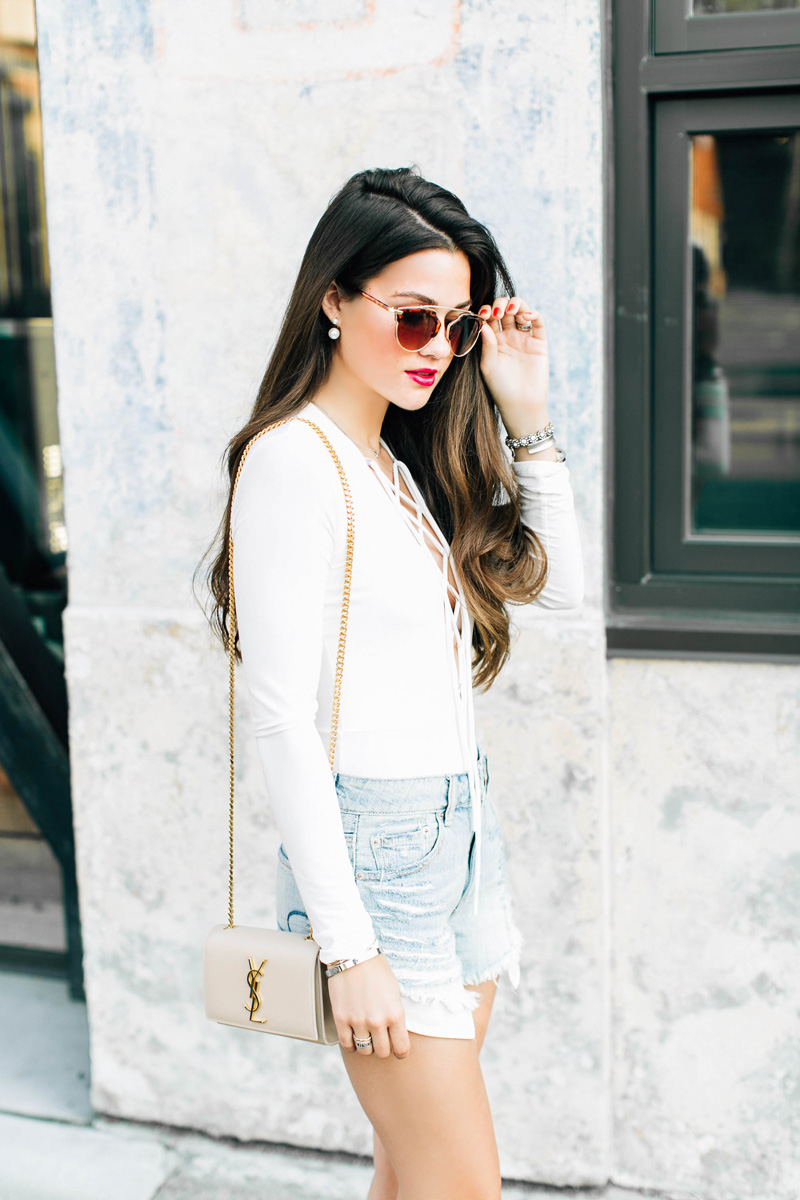 White lace up front Bodysuit Dior So Real 48mm Sunglasses Shredded denim cutoff shorts