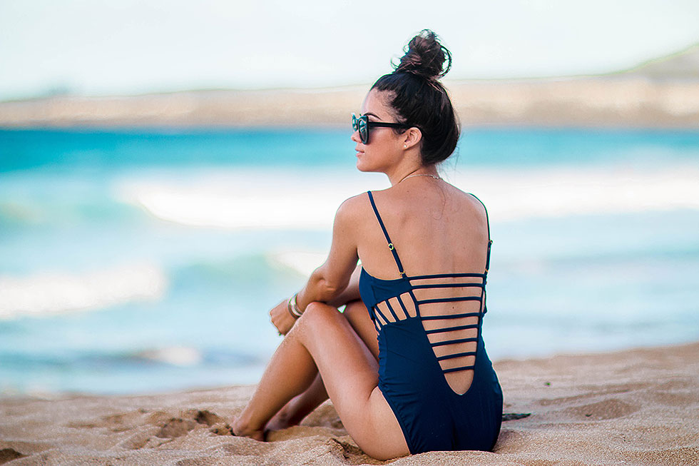 3 Swimsuits to Boost Your Holiday Style at the Beach cut out strappy one piece swimsuit