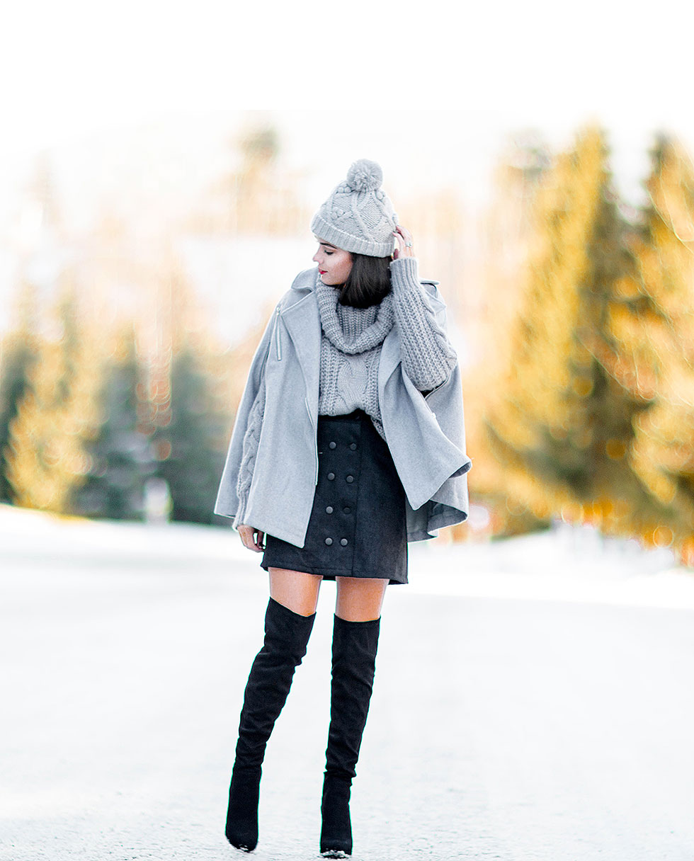 fashionable winter outfit idea for ski resort Whistler, Canada featuring Grey Cape Coat and Grey Cable Knit Sweater