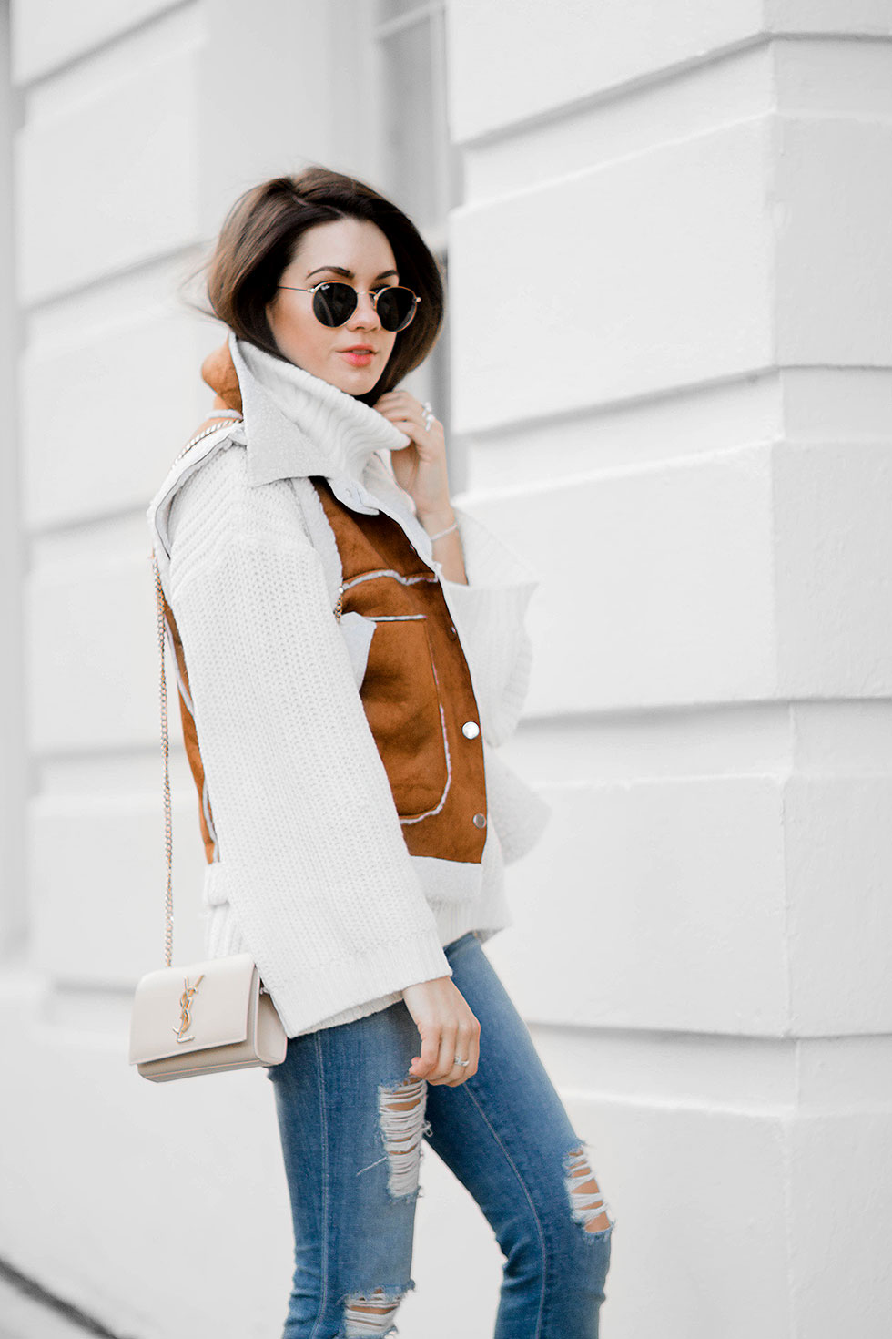 shearling vest outfit idea for winter --- featuring Rachel Zoe Jordy Turtleneck Sweater, Faux-Shearling Vest, Saint Laurent Monogramme Chain Shoulder Bag, Distressed Skinny Jeans, Ray Ban 50mm Retro Round Metal Sunglasses