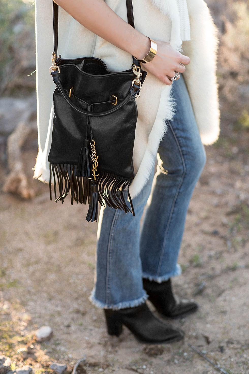 Theory Ivory Shearling Vest, Saint Laurent Monogram Fringe Bucket Bag, Madewell High Rise Cropped Jeans with Fringe Desert Outfit Arizona