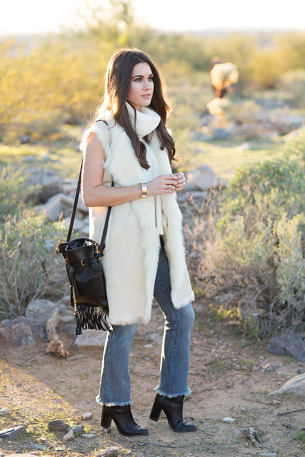 Theory Ivory Shearling Vest, Saint Laurent Monogram Fringe Bucket Bag, Madewell High Rise Cropped Jeans with Fringe Desert Outfit Arizona