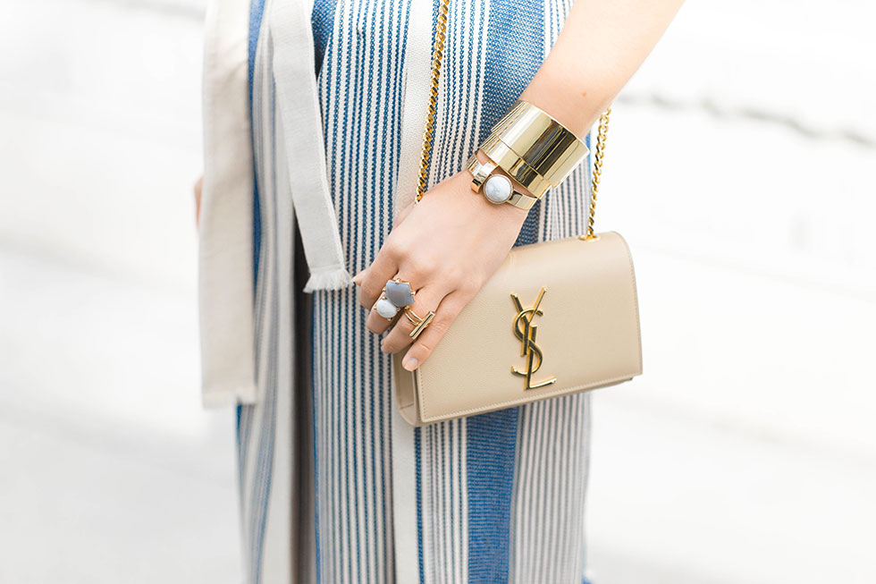 Gold Statement Jewelry and Saint Laurent Monogramme Chain Shoulder Bag, Capwell + Co Alyssa Cuff, Capwell + Co Gold Jamie Ring, Capwell + Co Gold Alexis Ring, Capwell + Co Earth and Sky Ring, BaubleBar Pisa Cuff