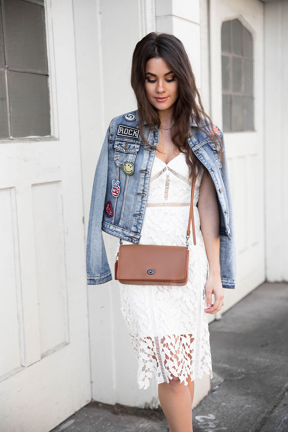 Update Your Classic Denim Jacket this April - Cropped Patchwork Denim Jacket, Lace Midi Dress, Coach Dinky Crossbody in Glovetanned Leather Spring Outfit