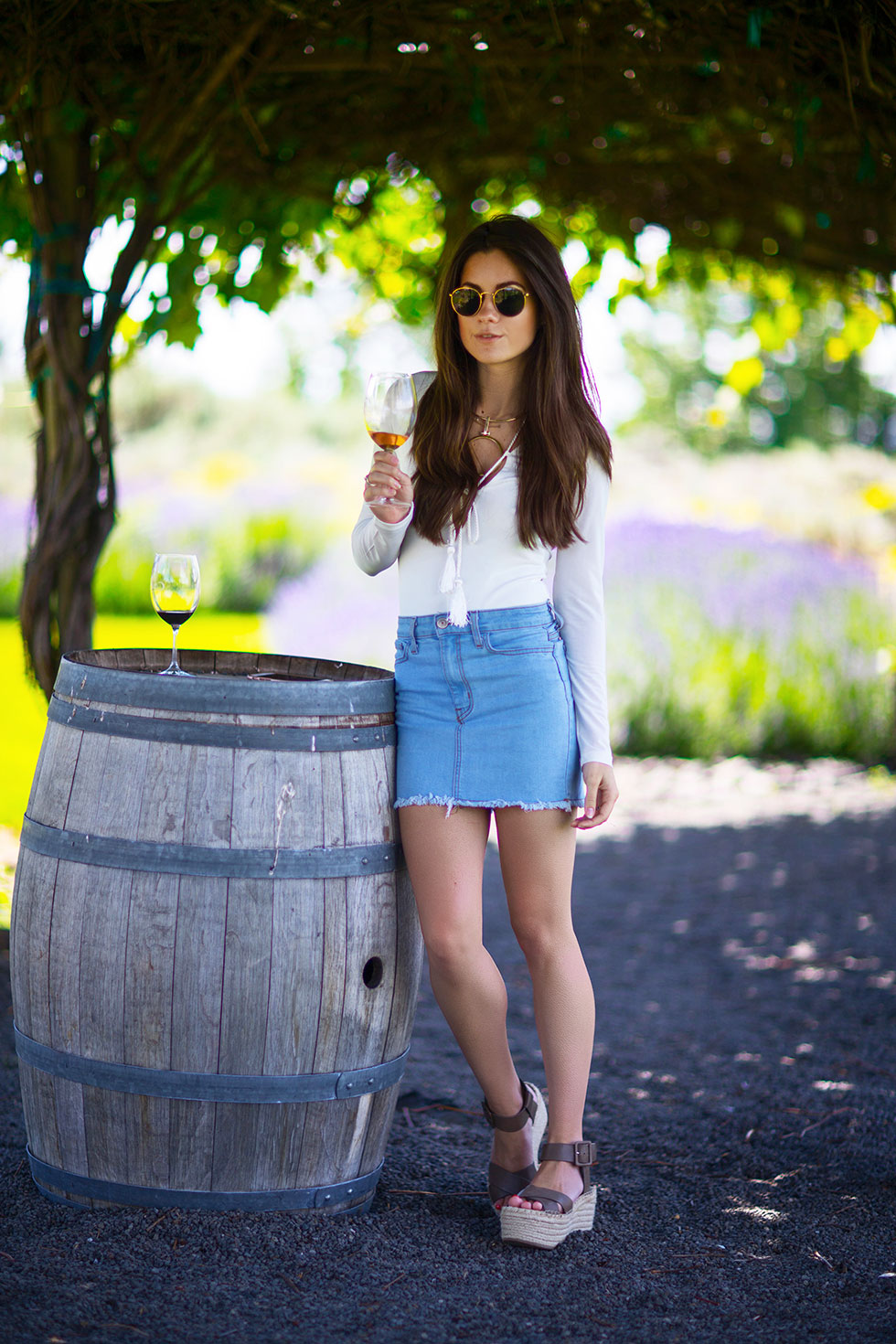 What to wear Summer Wine Tasting - Light Wash Denim Mini Skirt, long sleeve bodysuit with tasseled rope laced around the neckline, Cave B Inn and Spa Washington State Resort Quincy wine tasting-13