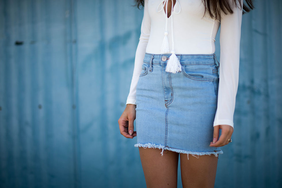 Light Wash Denim Mini Skirt, long sleeve bodysuit with tasseled rope laced around the neckline, Cave B winery, Sasquatch Music Festival, Fashion Blogger, Summer Denim Outfit