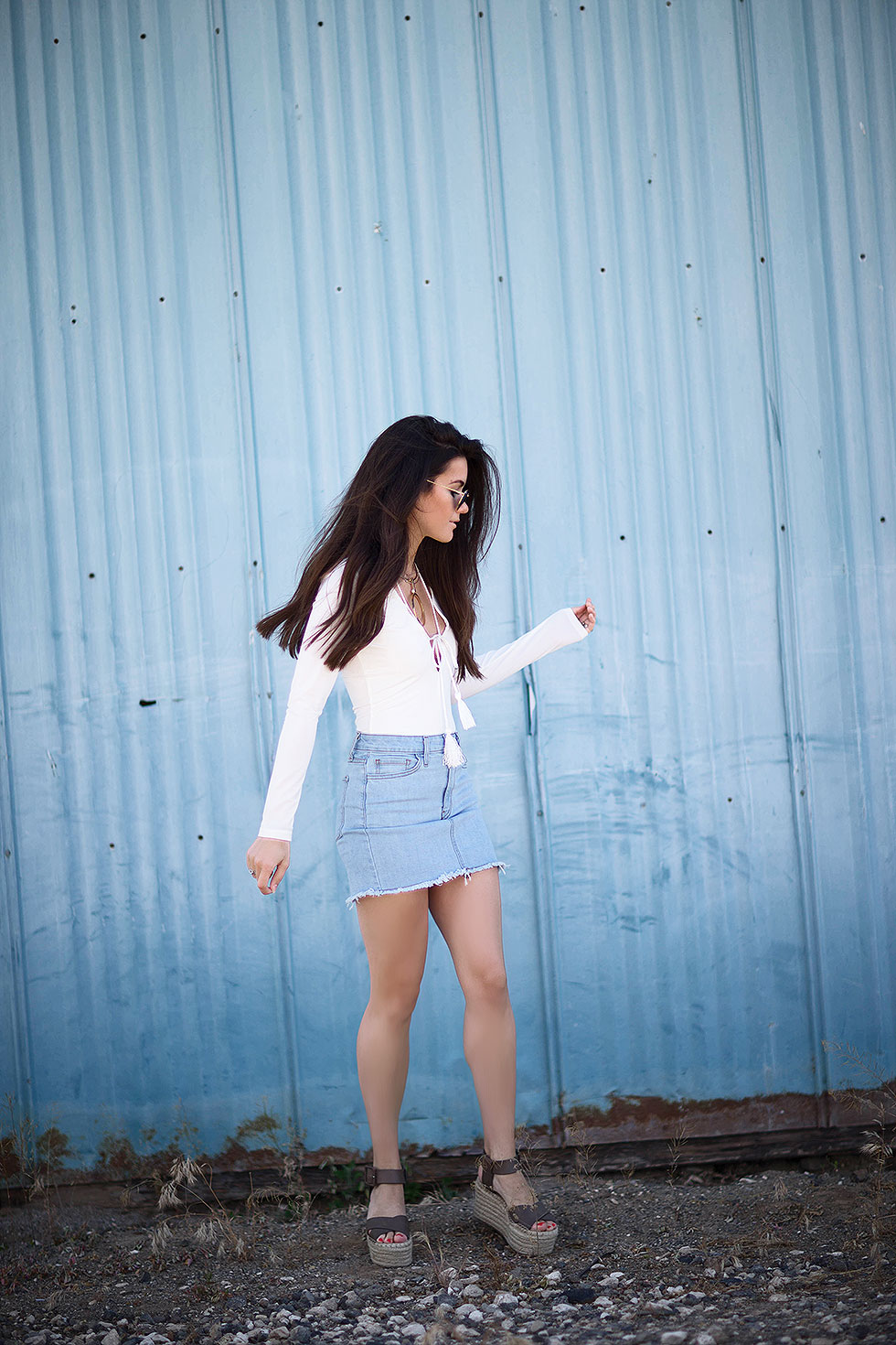 Why You Need A Denim Mini Skirt --- Light Wash Denim Mini Skirt, long sleeve bodysuit with tasseled rope laced around the neckline, Cave B winery, Sasquatch Music Festival, Fashion Blogger, Summer Denim Outfit