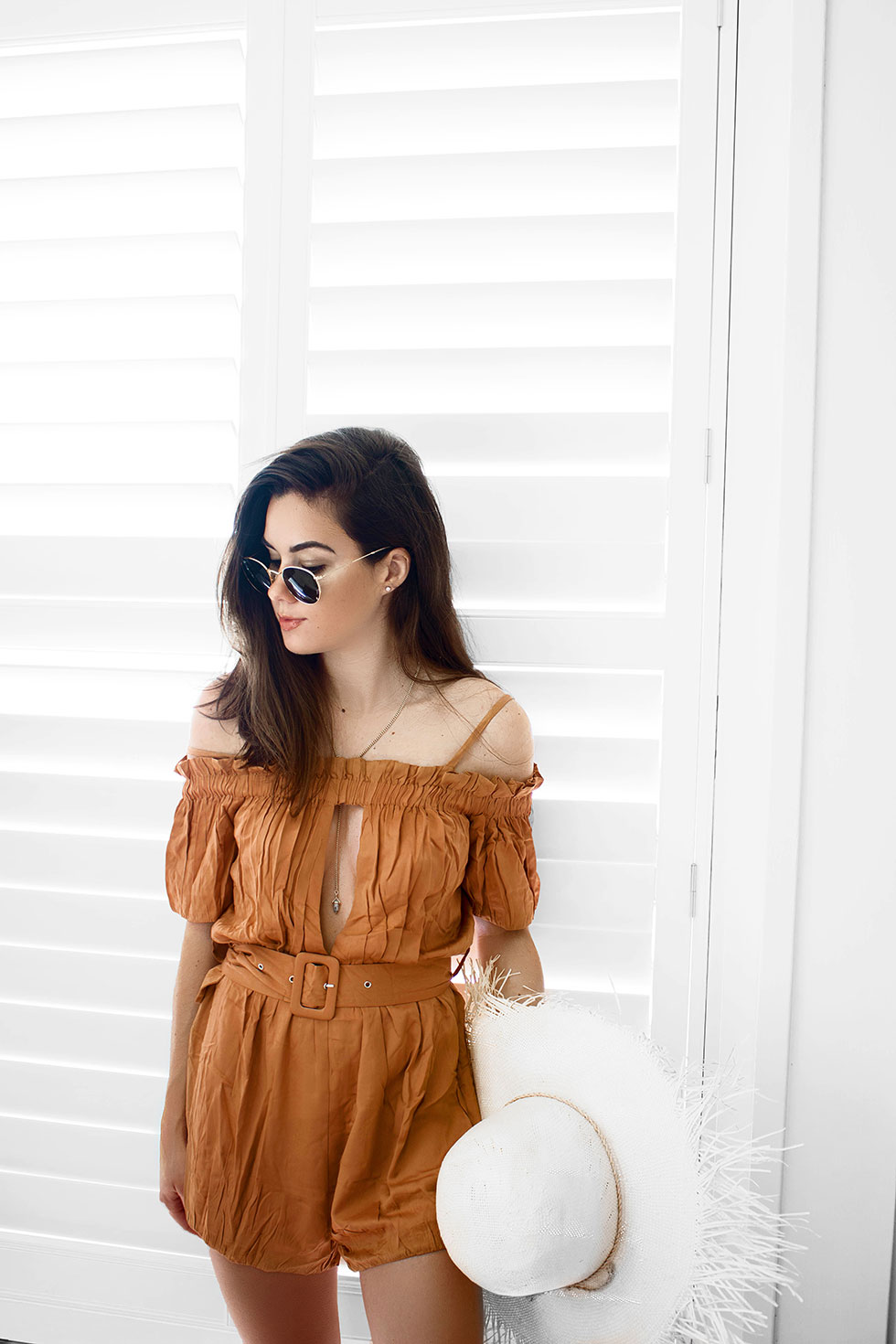 How to Pack for a Summer Beach Weekend --- yellow rust romper is a classic romper with an off-the-shoulder design, a slit chest and back, and belt that cinches around the waist