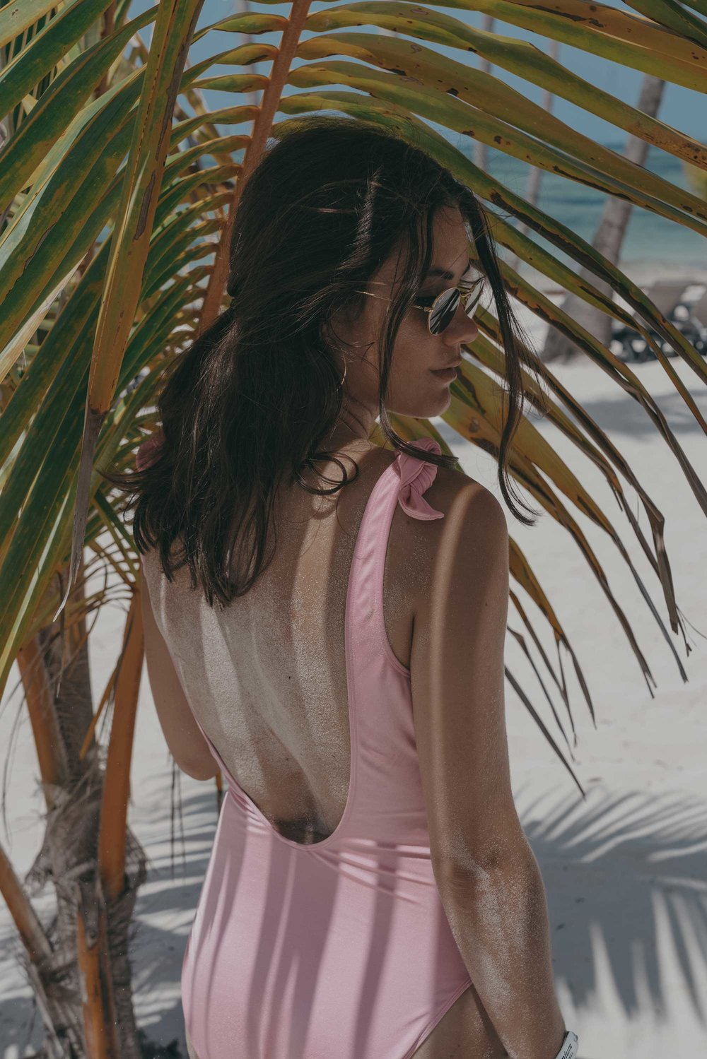 pink one piece swimsuit reading muchas dominican republic beach outfit9.jpg