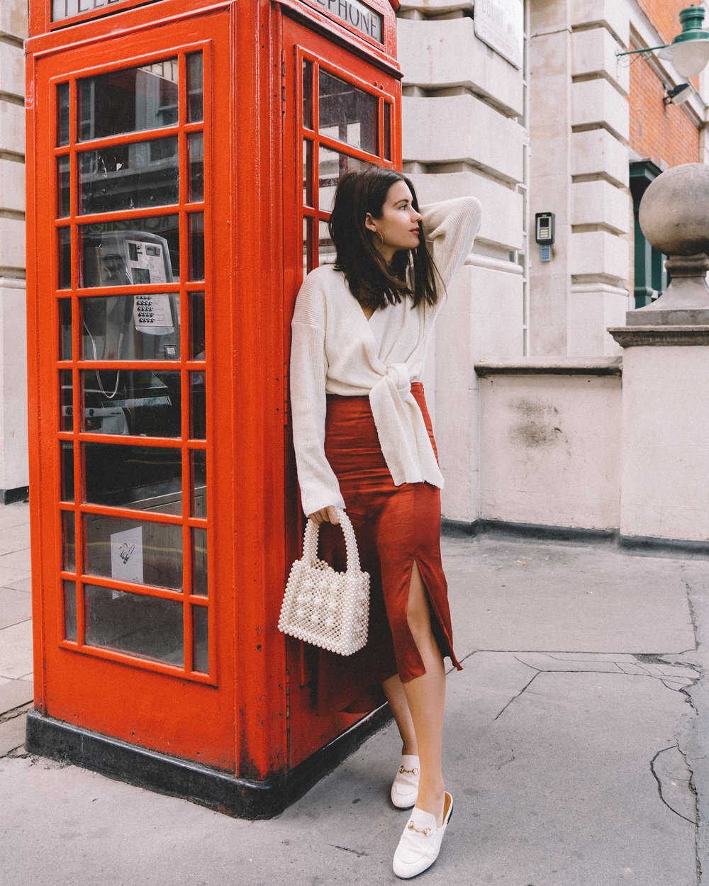 & Other Stories Asymmetric Slit Midi Skirt, Faux Pearl Handbag, Tied knot front Sweater london streetstyle outfit10.jpg