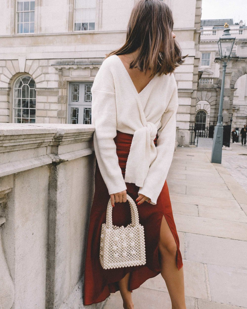 & Other Stories Asymmetric Slit Midi Skirt, Faux Pearl Handbag, Tied knot front Sweater london streetstyle outfit4.jpg
