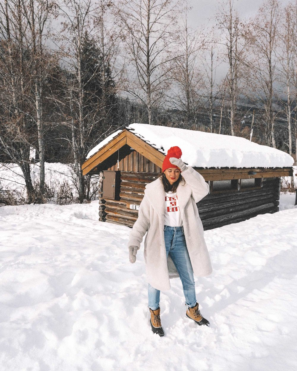 Winter snow outfit white faux shearling coat and sorel boots with jeans whislter canada9.jpg