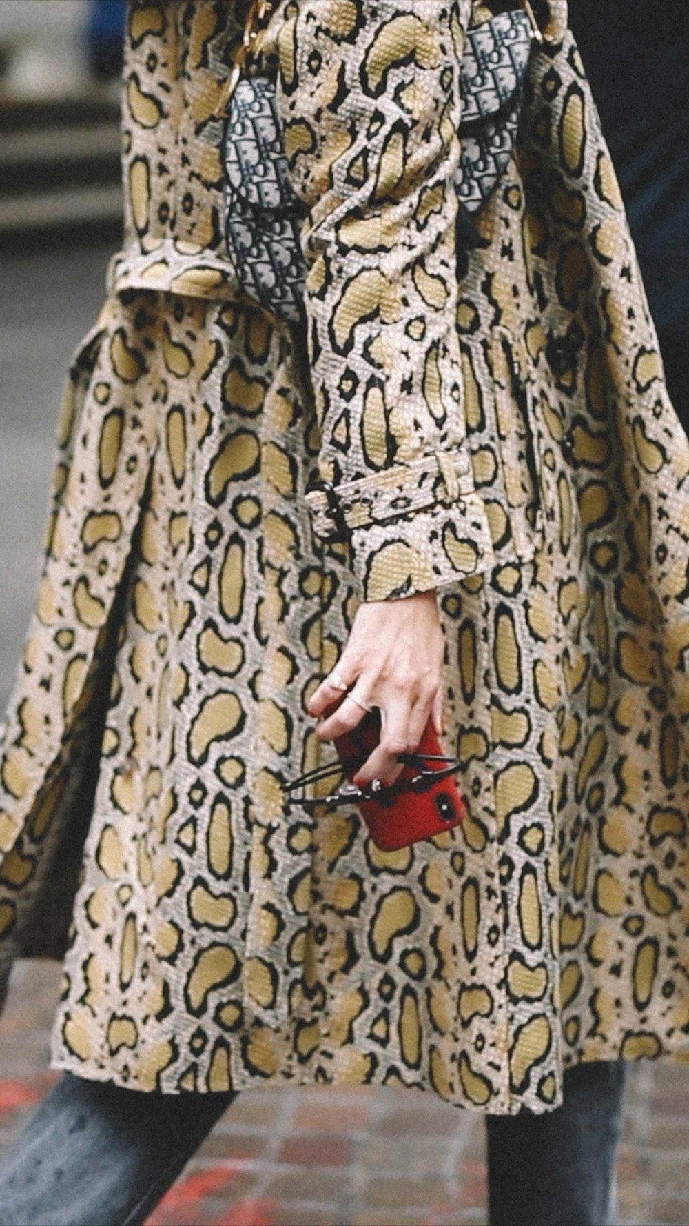 11 ways to wear snake print, snake print trench coat street style.jpg