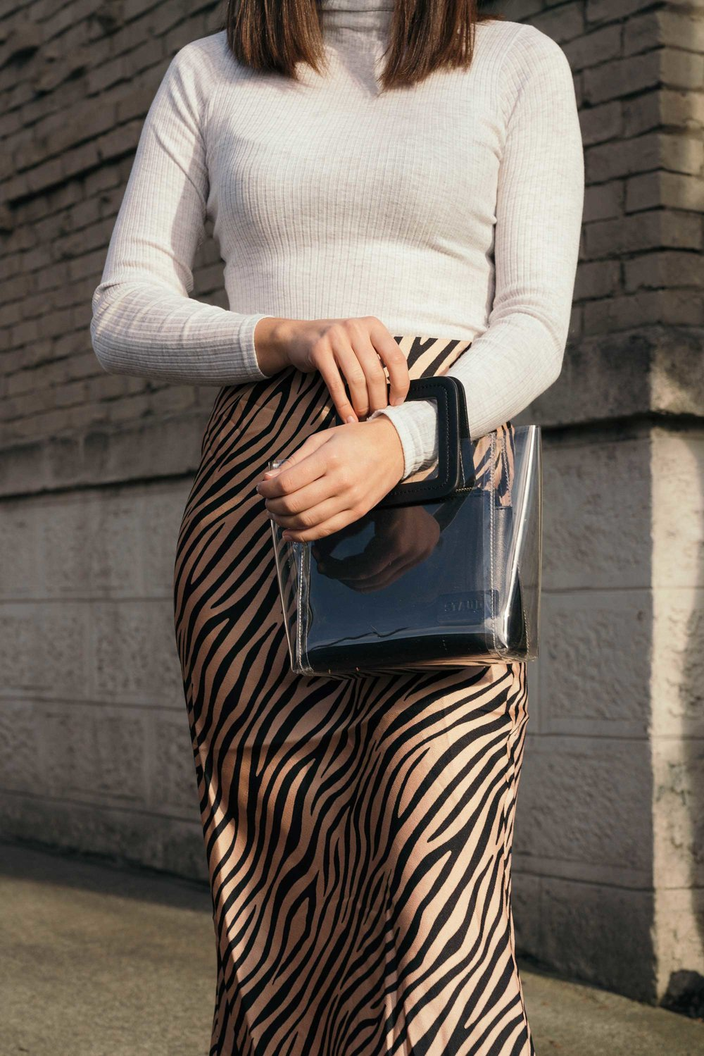 Sarah Butler of Sarah Styles Seattle wears Club Monaco Julie Rib Turtleneck Sweater, Tiger Print Midi Skirt, and Staud Mini Shirley Transparent Handbag | @sarahchristine5.jpg