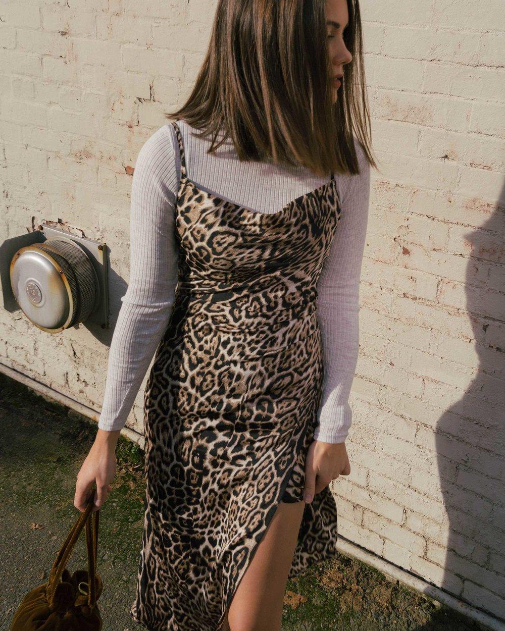 Sarah Butler of Sarah Styles Seattle wears Charmeuse Midi Leopard Print Dress, THE ROW Nude Asymmetric Leather Sandals, and Madewell Mini Velvet Crossbody handbag | @sarahchristine7.jpg