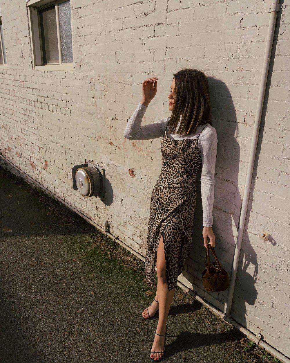 Sarah Butler of Sarah Styles Seattle wears Charmeuse Midi Leopard Print Dress, THE ROW Nude Asymmetric Leather Sandals, and Madewell Mini Velvet Crossbody handbag | @sarahchristine2.jpg