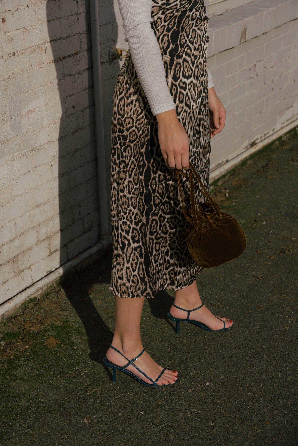 Sarah Butler of Sarah Styles Seattle wears Charmeuse Midi Leopard Print Dress, THE ROW Nude Asymmetric Leather Sandals, and Madewell Mini Velvet Crossbody handbag | @sarahchristine6.jpg