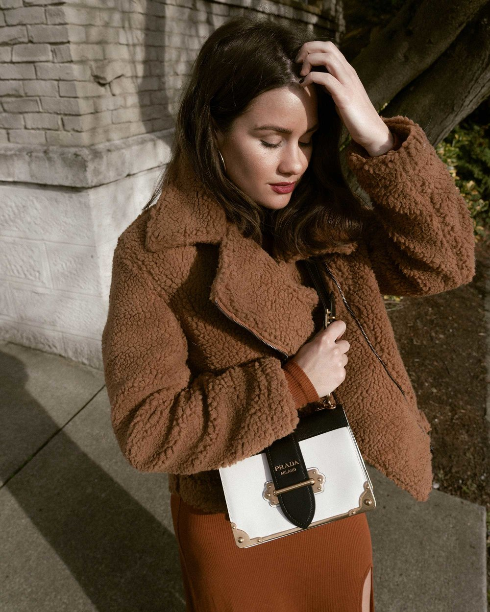 Sarah Butler of Sarah Styles Seattle wears ASTR the Label Faux Shearling Moto Jacket and Prada Saffiano Leather Cahier Bag for a causal winter outfit | @sarahchristine, Seattle Blogger12.jpg