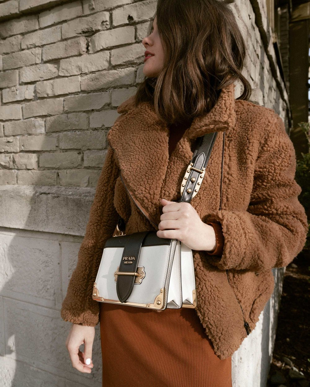 Sarah Butler of Sarah Styles Seattle wears ASTR the Label Faux Shearling Moto Jacket and Prada Saffiano Leather Cahier Bag for a causal winter outfit | @sarahchristine, Seattle Blogger16.jpg