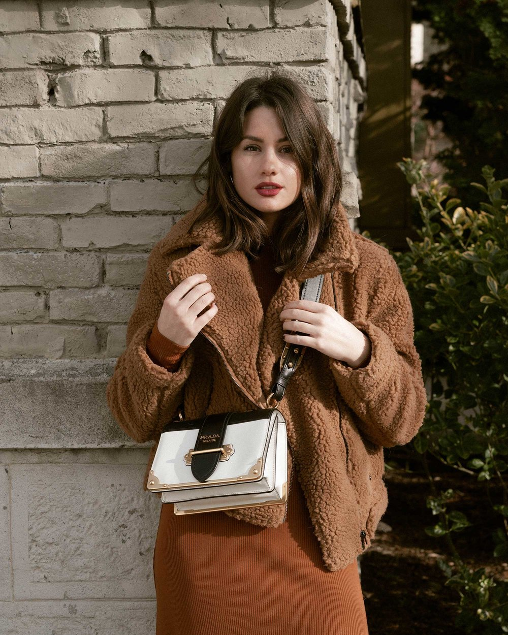 Sarah Butler of Sarah Styles Seattle wears ASTR the Label Faux Shearling Moto Jacket and Prada Saffiano Leather Cahier Bag for a causal winter outfit | @sarahchristine, Seattle Blogger13.jpg