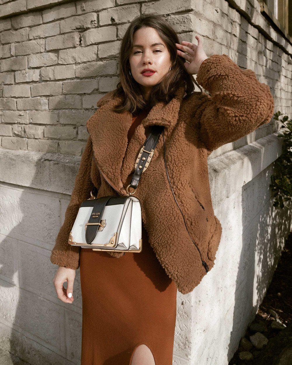 Sarah Butler of Sarah Styles Seattle wears ASTR the Label Faux Shearling Moto Jacket and Prada Saffiano Leather Cahier Bag for a causal winter outfit | @sarahchristine, Seattle Blogger17.jpg