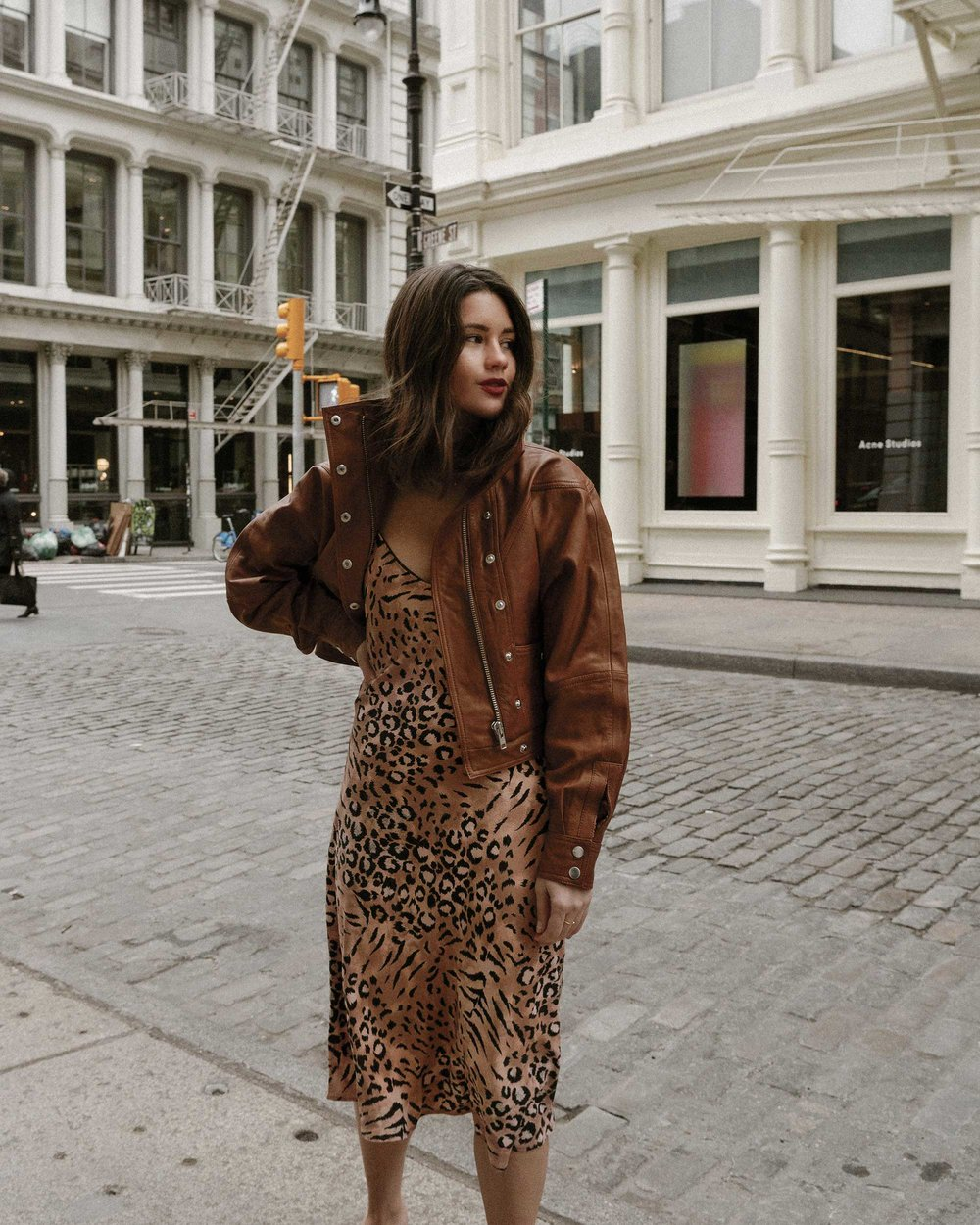 Sarah Butler of Sarah Styles Seattle wears PAIGE Cicely animal print slip dress and Revolve LPA oversized brown leather bomber jacket in Soho, New York | @sarahchristine, Seattle Blogger6.jpg