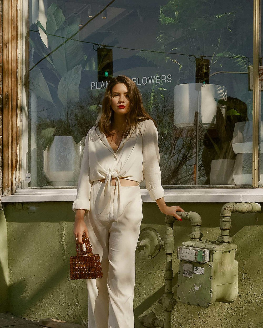 Sarah Butler of Sarah Styles Seattle wears Nanushka Long sleeve Tanya Tie-Front Jumpsuit and Cult Gaia Acrylic Cora Clutch in tortoise shell brown in Seattle   @sarahchristine, Seattle Blogger8.jpg