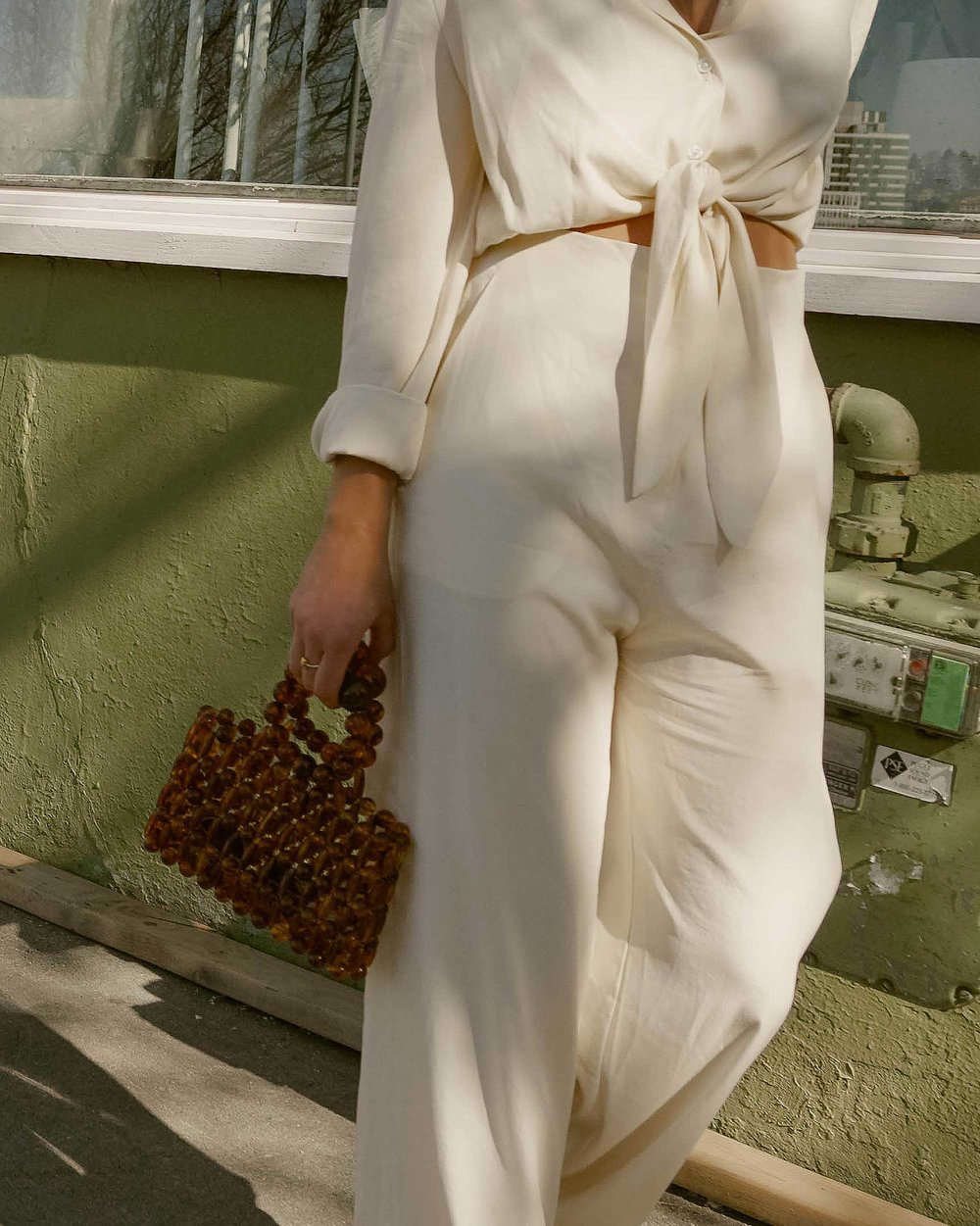 Sarah Butler of Sarah Styles Seattle wears Nanushka Long sleeve Tanya Tie-Front Jumpsuit and Cult Gaia Acrylic Cora Clutch in tortoise shell brown in Seattle   @sarahchristine, Seattle Blogger9.jpg