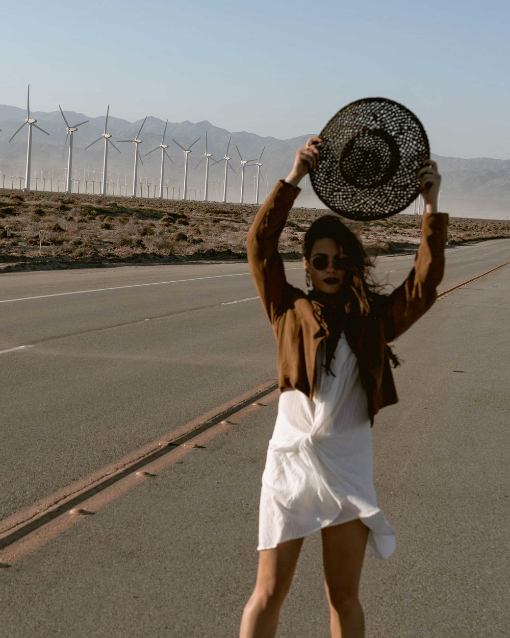 Sarah-Butler-of-Sarah-Styles-Seattle-wears-Jacquemus-Alassio-draped-white-cotton-mini-dress,-Paige-Darlene-Fringed-Suede-Jacket,-and-Paige-suede-western-boot-in-Palm-Springs-for-Coachella-Festival-Outfit-_-@sarahchristine5.jpg
