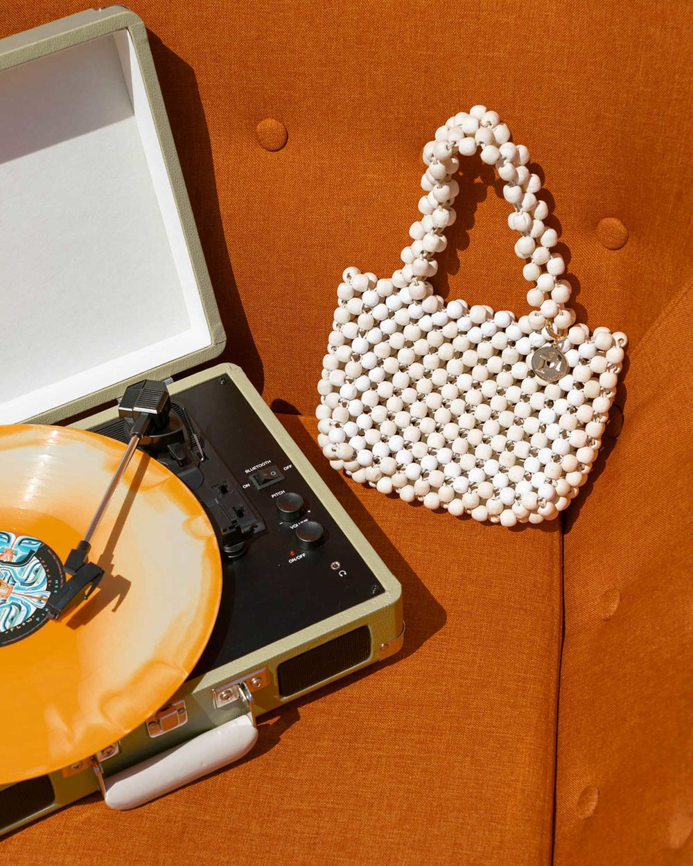 11 spring accessories to buy now:  THE ROW Nude Asymmetric Leather Sandals, Cult Gaia acrylic clutch , ROSANTICA beaded tote in Palm Springs | @sarahchristine - 6.jpeg