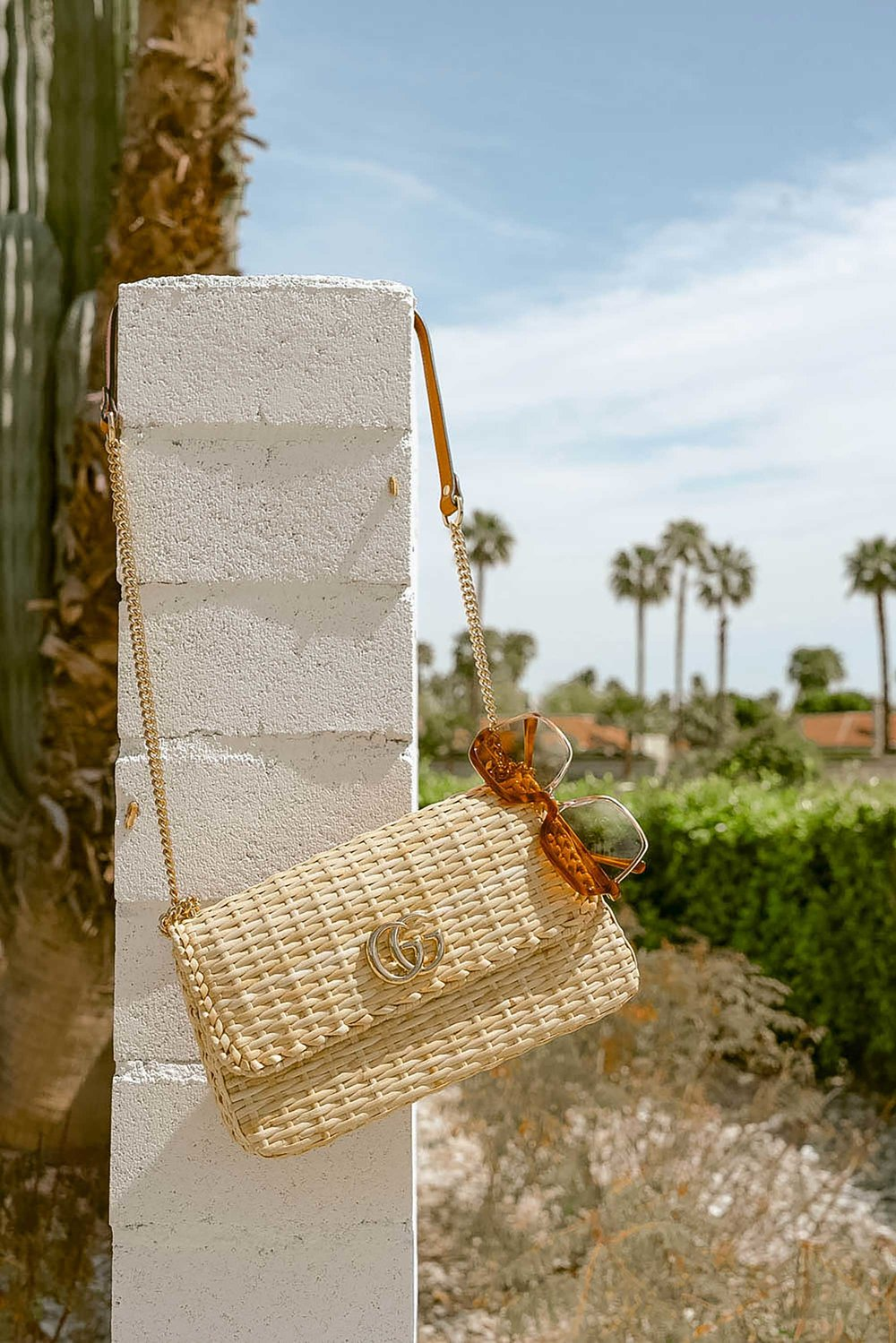 11 spring accessories to buy now:  THE ROW Nude Asymmetric Leather Sandals, Cult Gaia acrylic clutch , ROSANTICA beaded tote in Palm Springs | @sarahchristine - 17.jpeg