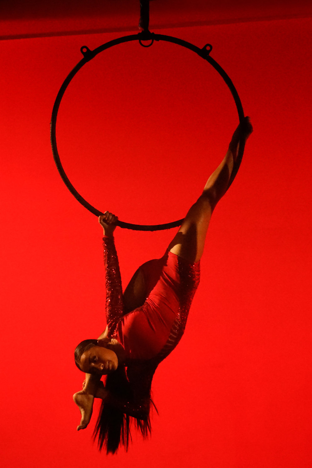 AERIAL LYRA - Aerial Lyra is a circular steel apparatus (resembling a hula hoop) suspended from the ceiling, on which circus artists may perform aerial acrobatics. It can be used static, spinning, or swinging. Students will learn the fundamentals of aerial acrobatics whilst building strong & flexible bodies. Aerial Lyra requires a lot of upper body strength and core strength.