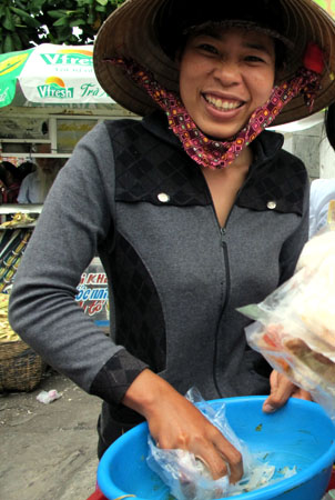 The lady who sells bánh tráng nướng next to our school.