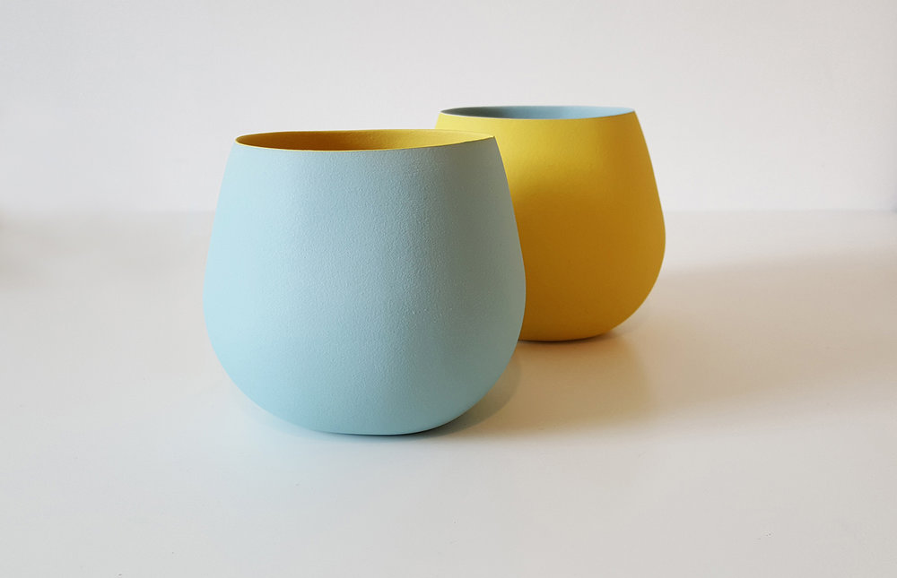 Wide open vessel forms  - pale blue, yellow and yellow, pale blue - height approx 10cm