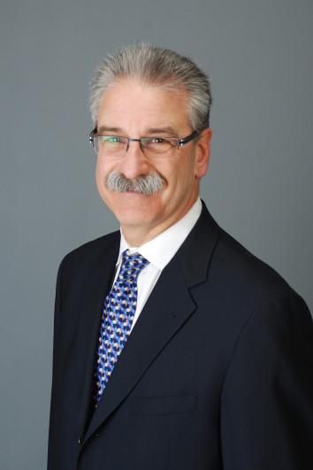 Dr. Dennis E. Lee
