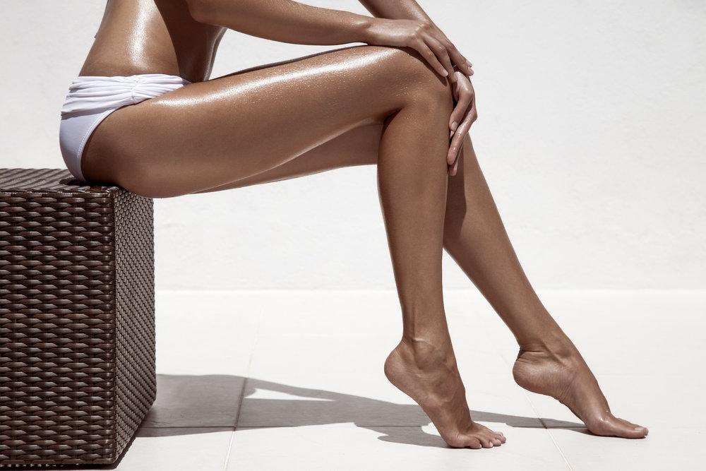 Beautiful-woman-tan-legs.-Against-white-wall-000051839410_Double.jpg