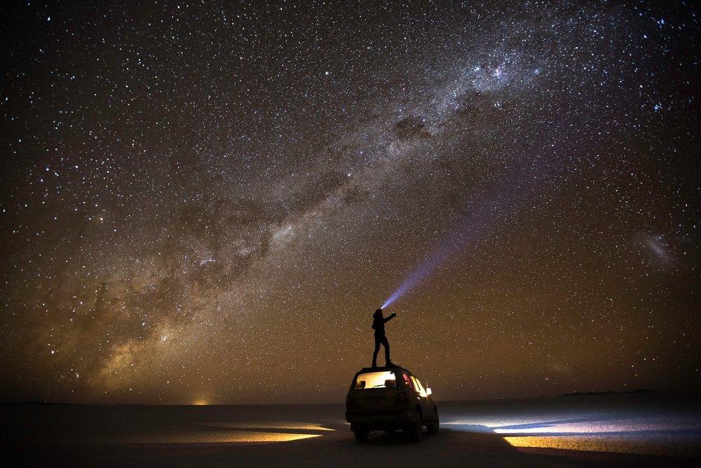 Millenial Man. Shining a light through basicness. Salar de Uyuni, Bolivia