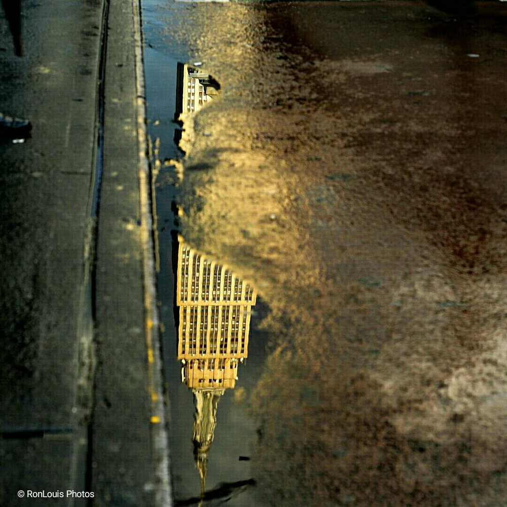 """Curbside Reflection"" Photographed by Ron Foster in New York City, New York"