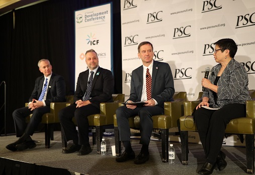 COO Carol Yee moderates a panel with USAID Administrator Mark Green at the PSC Development Conference held on December 4, 2018.