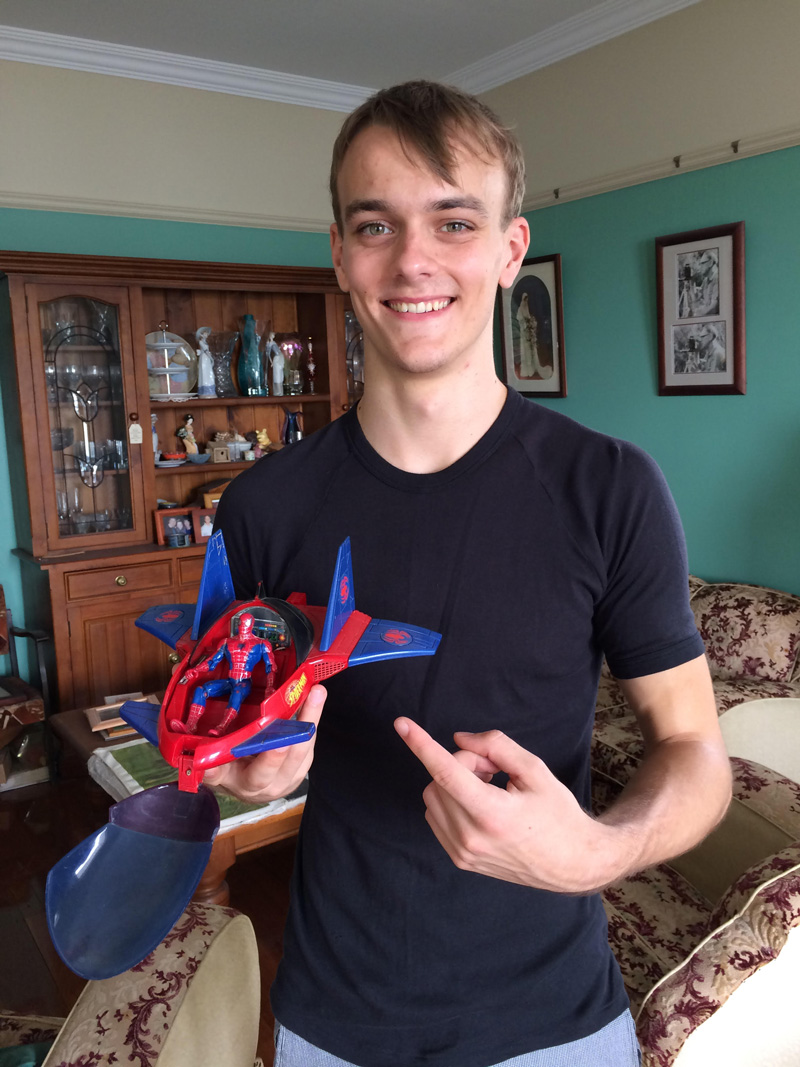 Adam Strom with his Spiderman toy, his reward from his parents for sticking with the circus.