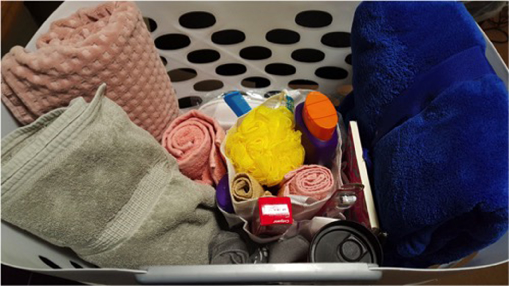 The welcome basket includes a variety of items such as shampoo, wash cloths and bath towels to name a few.