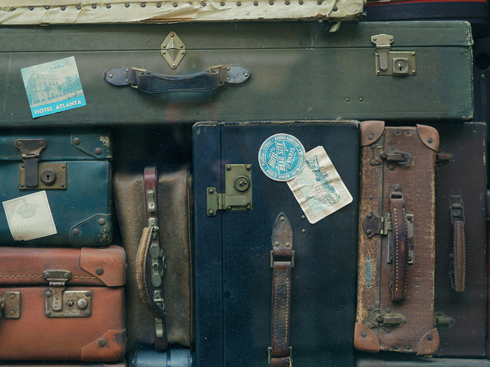antique-suitcases-stacked-together