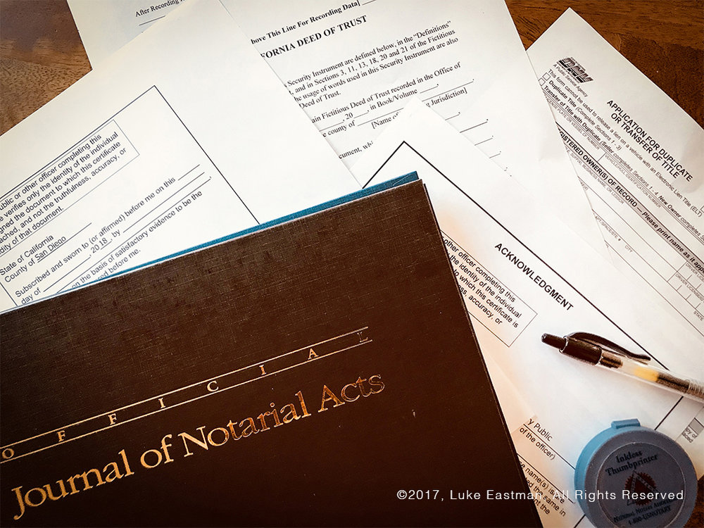 notary-journal-on-table-with-documents