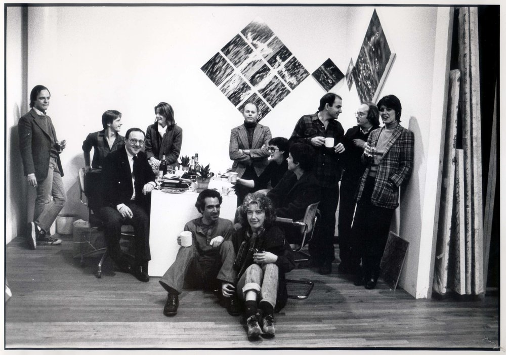Douglas Baxter's birthday, Paula Cooper Gallery, New York, circa 1980. From left: Julian Lethbridge, Douglas Baxter, Max Gordon, Julie Graham, Peter Campus, Elizabeth Murray, Marc Lancaster, Ellie Griffin Jack, Jennifer Bartlett, Joel Shapiro, Michael Hurson, Paula Cooper. Art on wall by Jennifer Bartlett.