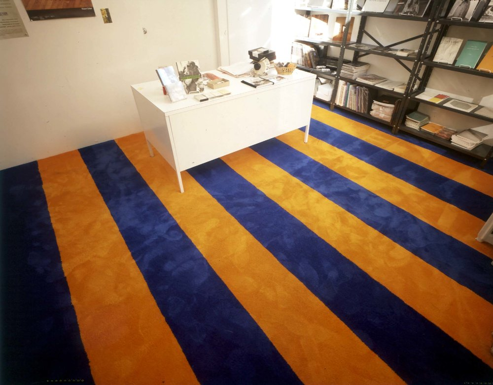 Rudolf Stingel's carpet installation at the gallery's bookstore located at 149 Wooster Street. Paula Cooper Gallery expanded to 149 Wooster Street from 1988 through 1994, adjoining the main gallery at 155 Wooster Street. Well-known for his carpet installations, Stingel presented one of his earliest here in the early 1990s, curated by Nick Cooper, who ran the bookstore.