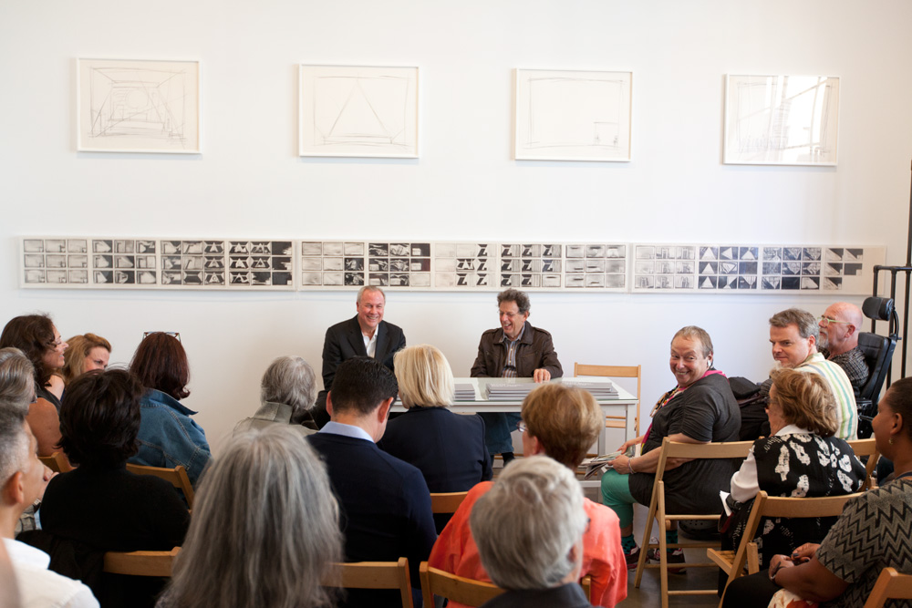 "Robert Wilson and Philip Glass in conversation during the exhibition ""Einstein on the Beach,"" Paula Cooper Gallery, New York, NY (September 12 – October 20, 2012)."