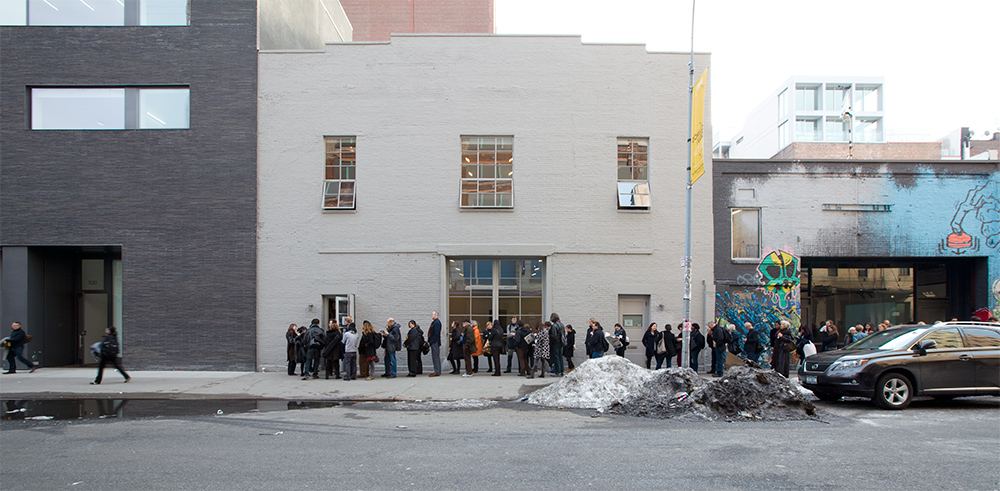 The line outside the gallery to view Christian Marclay's US premiere of his acclaimed work  The Clock  at 534 West 21st Street during the winter of 2011. Masses of visitors came and went at all hours of the day and night throughout the 24-hour screenings.