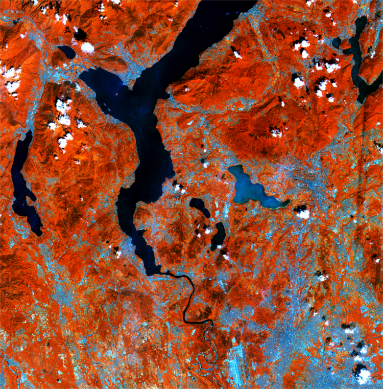 Lakes on the southern side of the Italian Alps are pictured in this early acquisition by the Sentinel-2A satellite (Copernicus/ESA). Processed using the high-resolution infrared channel of the satellite's multispectral camera, the image shows healthy vegetation in red, such as the hills and mountains in the upper part of the image.  Lakes on the southern side of the Italian Alps are pictured in this early acquisition by the Sentinel-2A satellite (Copernicus/ESA). Processed using the high-resolution infrared channel of the satellite's multispectral camera, the image shows healthy vegetation in red, such as the hills and mountains in the upper part of the image.