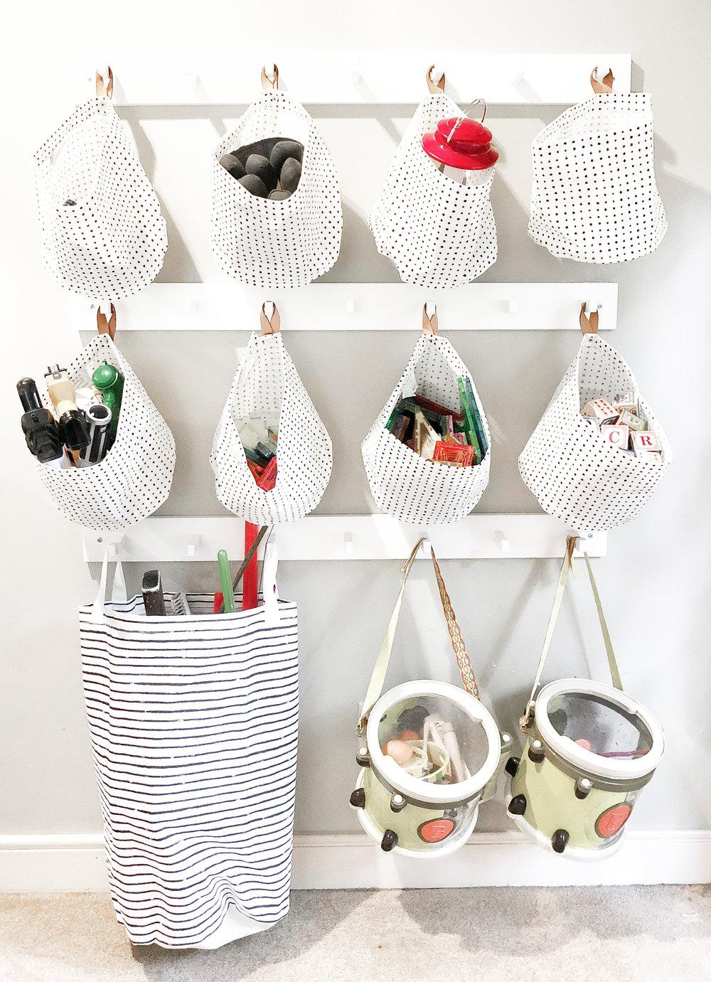 Ikea Kubbis hooks    with    Klunka laundry bag    or    Plumsa storage bags