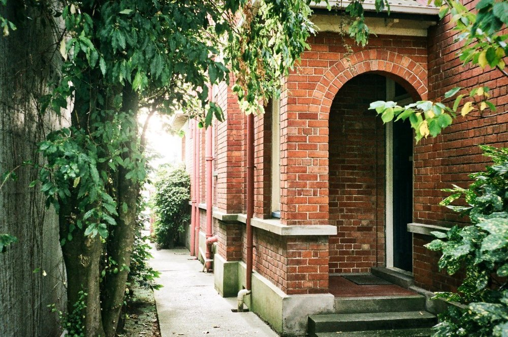 side-entrance-to-old-brick-building-used-as-a-lawyers-office-in-invercargill.jpeg